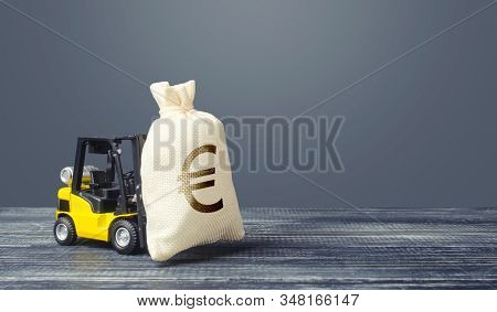 Yellow Forklift Carries A Euro Money Bag. Grants Financing. Payment Of Taxes. Big Contract, Profitab