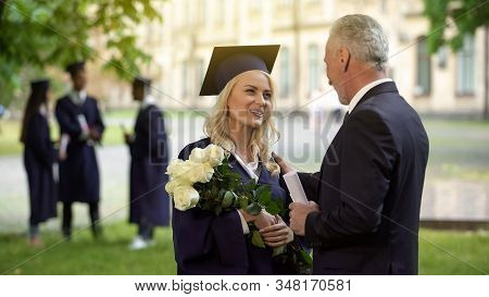 Father Giving Flowers To His Graduate Daughter, Congratulations, Paternal Pride