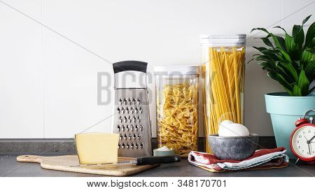 Kitchen Utensils With Products On The Background Of The Kitchen, Place Fo Text.