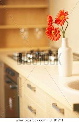 Beautiful Flower On Table In Modern Kitchen