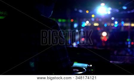 Deejay Performing For Excited Audience, People On Dance Floor Enjoying Music Set
