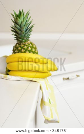 Bananas And Ananas On Kitchen\'S Table