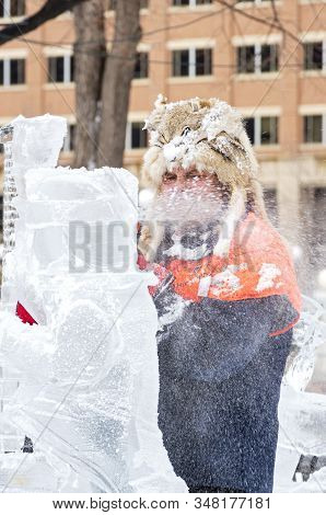 St. Paul, Mn/usa - January 25, 2020: Ice Sculptors On Ground Shaping Ice During Competition At Saint