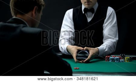 Experienced Casino Croupier Making Shuffling Tricks With Cards, Chance To Win