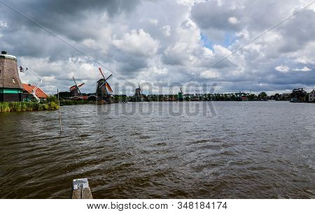 Zaanse Schans, Holland, August 2019. Northeast Amsterdam Is A Small Community Located On The Zaan Ri