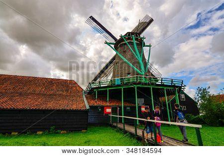Zaanse Schans, Holland, August 2019. Northeast Amsterdam Is A Small Community Located On The Zaan Ri