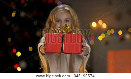 Little Girl Holding Gift Box, Sharing Presents With Orphaned Children At Xmas