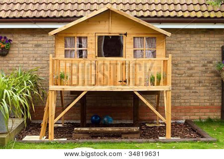 Childrens Wooden Treehouse In The Garden
