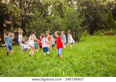 Kids Playing Funny Games In A Park In Summer Time