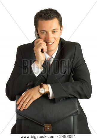 Businessman With Cellphone And Briefcase