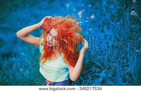 Happy Young Redhead Woman Sitting Outdoors With Closed Eyes In Summer Park Peaceful Girl Enjoy Rest