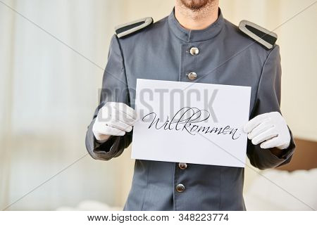 Servant in the hotel holds a