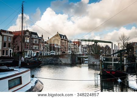 Photo Of The Historic Delfshaven With Beautiful Colored Clouds In Rotterdam, And Is The Birthplace O