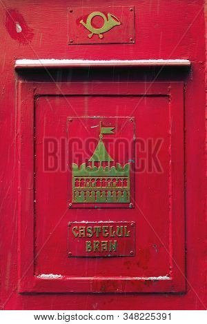 Bran, Romania- January 05, 2020: Close Up View Of Ancient Red Post Box With Some Snow In Famous Bran