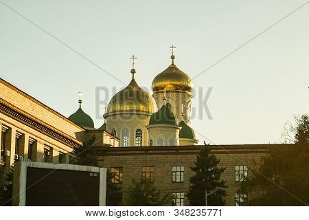 Domes Of The Trinity Church In Dnipro City In Ukraine. Orthodox Christianity Religion. The Photo Is