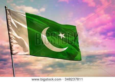 Fluttering Pakistan Flag On Colorful Cloudy Sky Background. Pakistan Prospering Concept.