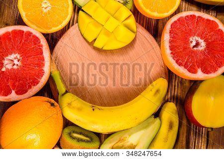 Still Life With Exotic Fruits And Cutting Board. Bananas, Mango, Oranges, Avocado, Grapefruit And Ki