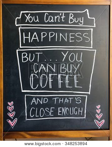 A Amusing Sign Relating Happiness To Coffee.