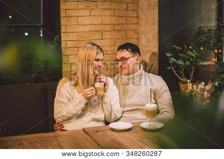 Happy Couple Meeting And Drinking Coffee. Love And Romantic Date In Downtown Cafe Restaurant. Young