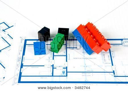 Blueprint For A House And Plastic Blocks