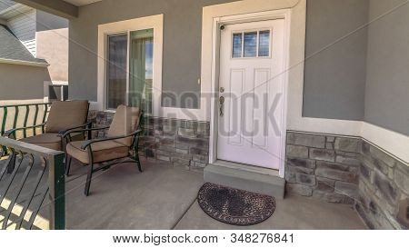 Panorama Entrance Of Home With Chairs At The Porch And Front Door With Glass Panes