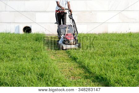 An Electric Rotary Lawn Mower Machine (mower, Grass Cutter Or Lawnmower) For Mower, Cutting Lawn Are