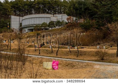 Gadeok-myeon, South Korea; January 26, 2020: Administrative Building On Hilltop Over Looking Burial