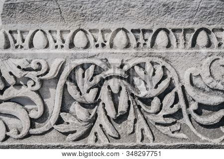 Decorative Stone Carving On An Antique Marble Column. Stone Column Of The Ruins Of An Ancient City.