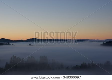 Sea Of Fog With Forest Island In Sunset Light, Overlooking The Swiss Mountainrange Of Jura