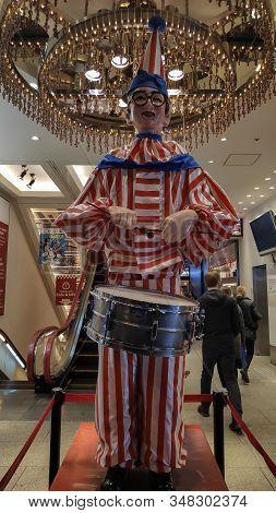 Osaka, Japan- 27 Nov, 2019: Kuidaore Taro Clown, A Mechanical Puppet, In Front Of The Now Defunct Ku