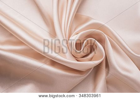 Smooth Elegant Wrinkled Silk Fabric Background. Abstract Crumpled Satin Texture. Cream Color. Soft W
