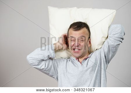 Man Sleepy Tired Wearing Nightwear Holding Pillow. Health Balance Sleep Deprivation Concept. Male At