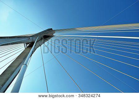 Modern Bridge Pylon Against A Blue Sky