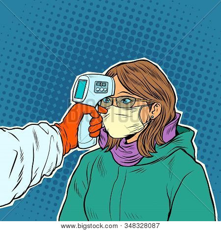 A Doctor Measures The Temperature Of A Woman In A Medical Mask. Novel Wuhan Coronavirus 2019-ncov Ep