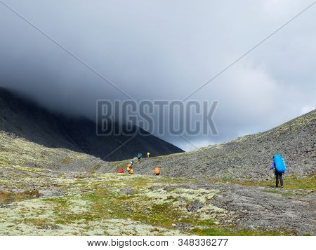 Mountain Landscape With Tourists On A Cloudy Day. Murmansk Region, Located In The Central Part Of Th