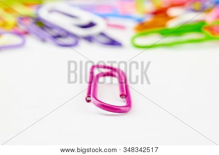 Bright Paper Clips On White Background. Pink Crimson, Blue, Purple Paperclips Memo Note And Document