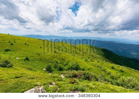 Green Meadows In Mountains With Clouds On The Sky. Wonderful Summer Nature Landscape Of Carpathians.