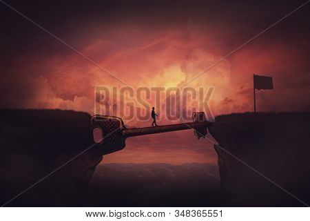 Conceptual View, Businessman Crosses A Chasm Obstacle Balancing On A Huge, Golden Key Shaped Bridge.