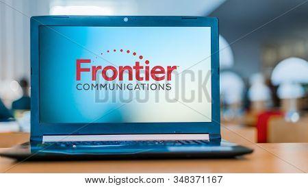 Poznan, Pol - Dec 11, 2019: Laptop Computer Displaying Logo Of Frontier Communications Corporation,
