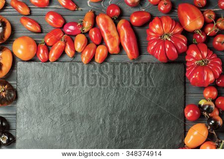 Different Kinds Tomatoes Mix. Colorful Tomatoes Of Different Sizes