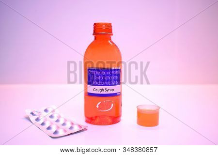 Abstract Background Of Cough Syrup, Cough Syrup Bottle Isolated On White Background, Medicine Syrup