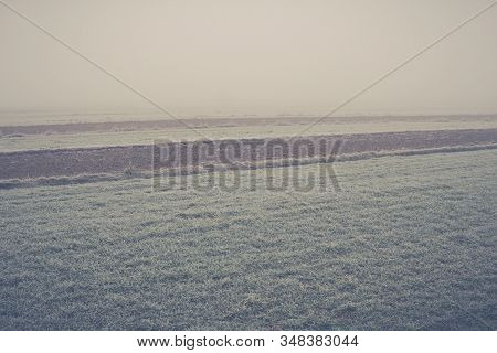 Fields In A Fog Covered With Frost