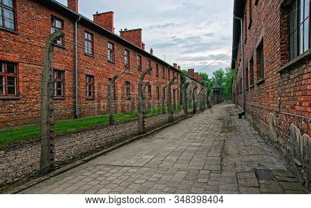 Barbed Wire And Barracks Of Auschwitz Concentration Camp