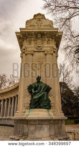 Monument To Alfonso Xii In The Retiro Park, On A Cloudy Day In Madrid. Travel Concept.