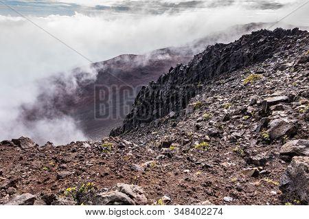 Haleakala Volcano, Maui, Hawaii, Usa. - January 13, 2020: Whtie Fog Rises Out Of Crater. Brown, And