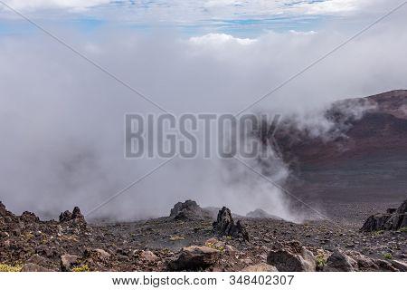 Haleakala Volcano, Maui, Hawaii, Usa. - January 13, 2020: Whtie Fog Lingers In Crater. Brown, And Bl