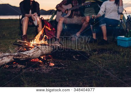 Camping Tent Camp In Nature Happy Friends Group Night Party Bonfire And Playing Guitar Together In S