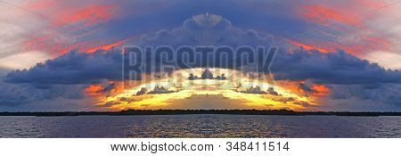 A Striking Inspirational Crimson & Gold Coloured Cloudy Coastal Sunrise Sunset Panorama In Over The
