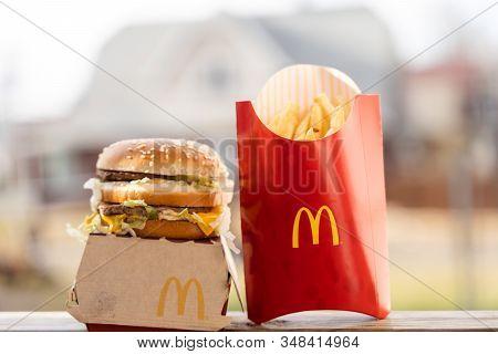 Rockford, Usa - Dec 28, 2019: Big Mac Box With Mcdonald's Logo And French Fries In Mcdonald's Restau