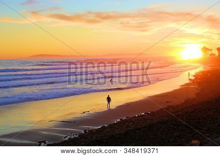 January 27, 2020 In Ventura, Ca:  People Walking The Beach During Sunset After A Day Of Surfing Larg